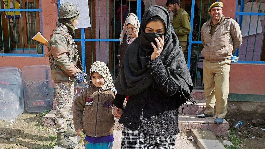 File image of a woman walking out of a polling station in J&K's Srinagar. Photo used for representation.