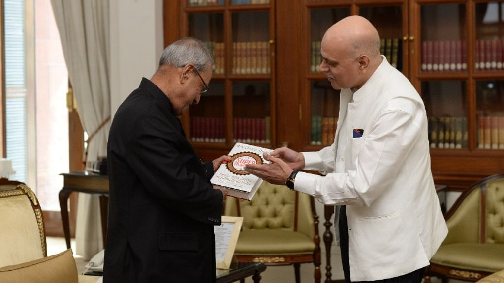Raghav Bahl Presents President Mukherjee His Book 'SuperEconomies'