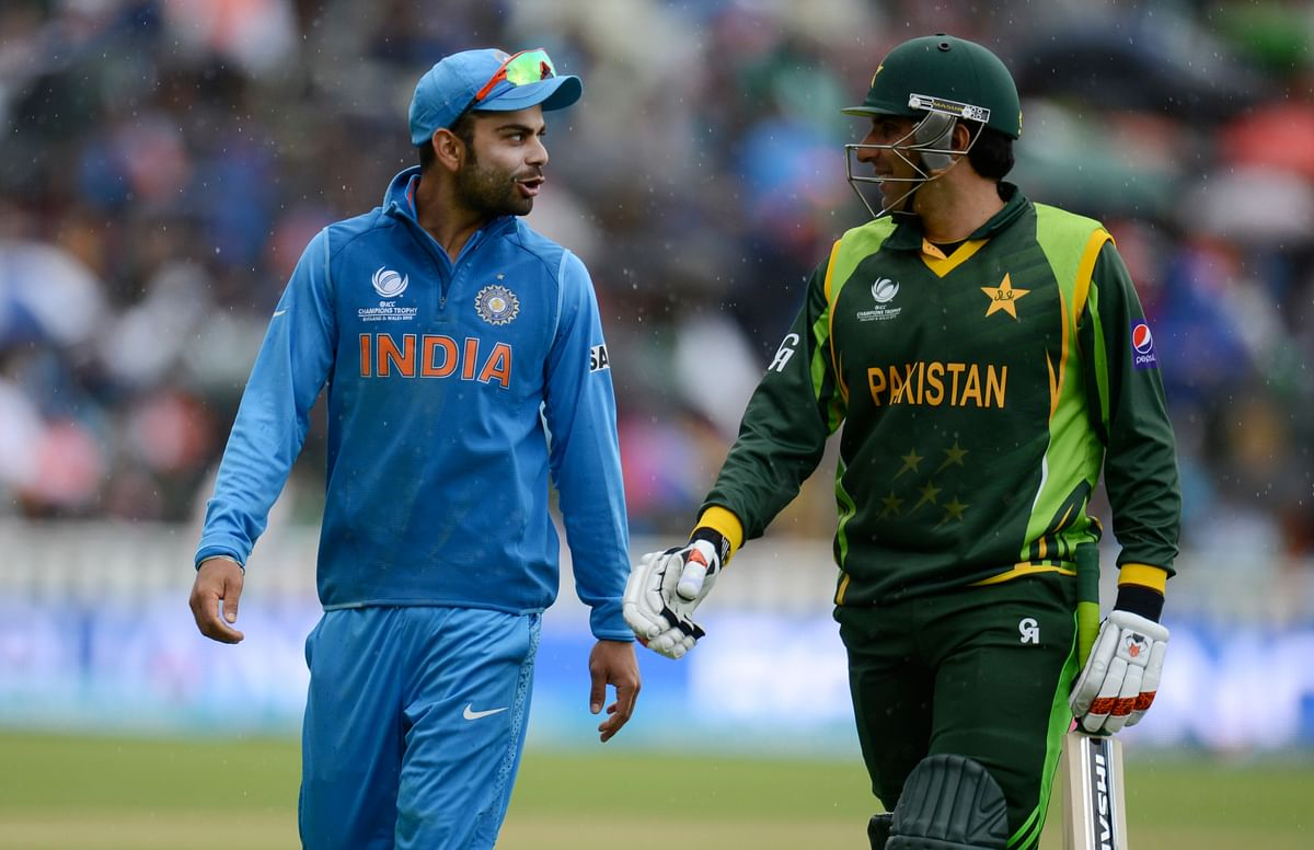 Virat Kohli (L) chats with Misbah-Ul-Haq during the 2013 Champions Trophy match in Birmingham. (Photo: Reuters)