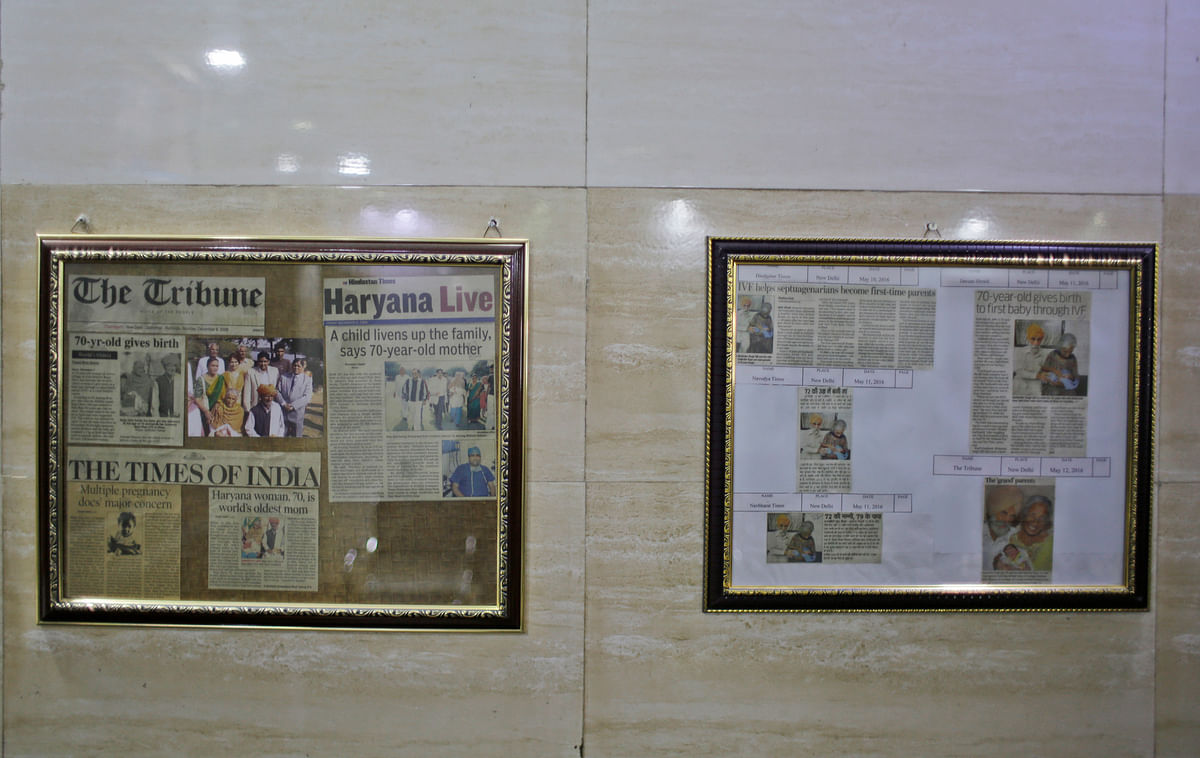 Framed newspaper clippings on patients are hung on a wall inside the National Fertility and Test Tube Baby Centre in Hisar. (Photo: AP)