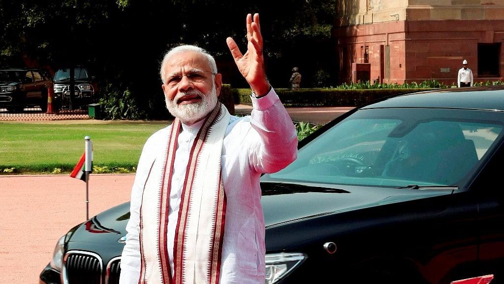 Prime Minister Narendra Modi waves to media. (Photo: PTI)