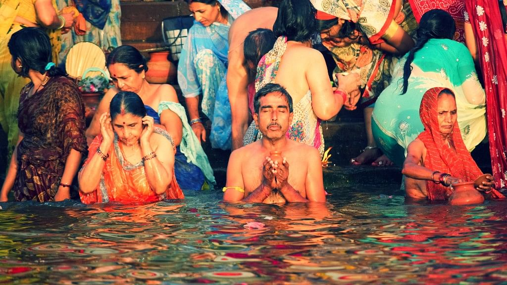 The young and old celebrate the confluence of ignorance towards filth and religious fervour with a dip into the Ganga. (Photo: iStock)