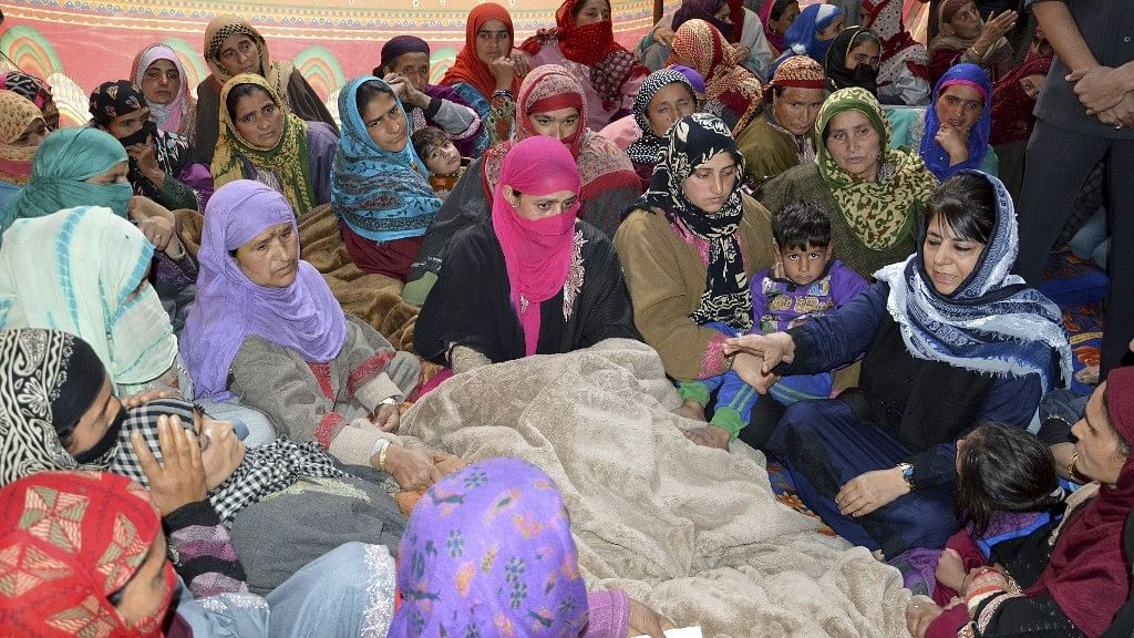 Kulgam: Jammu and Kashmir Chief Minister Mehbooba Mufti visits the family of JK Bank employee who was killed by the suspected militants during thier cash van loot. (Photo: PTI)