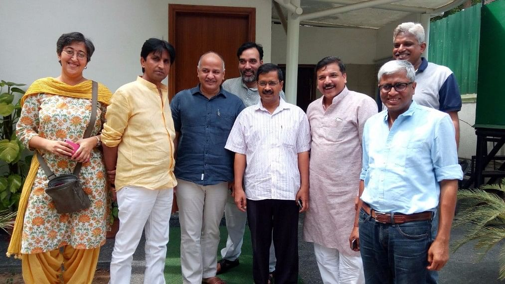 """The AAP members, including Arvind Kejriwal (centre) and Kumar Vishwas (second from left) after the PAC meeting. (Photo Courtesy: Twitter/<a href=""""https://twitter.com/vikaskyogi"""">Vikas Yogi</a>)"""