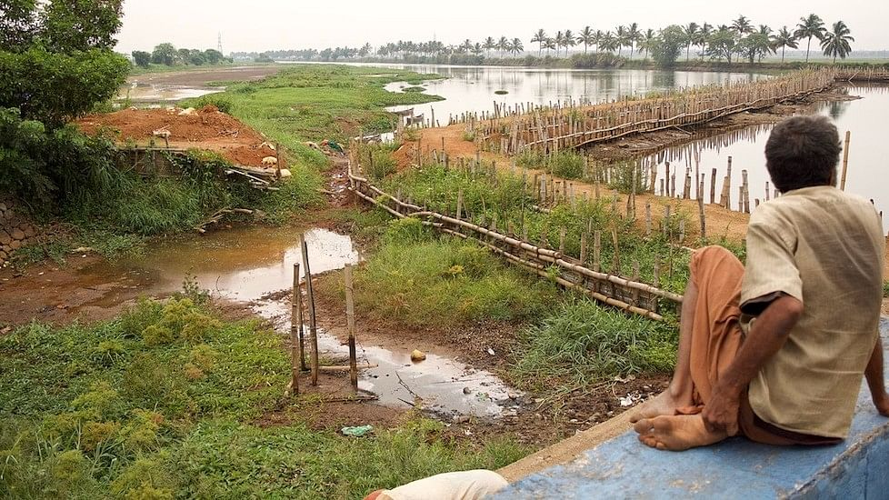 The vast expanse of water has degenerated into smaller water patches upstream of the Enamavu barrage. (Photo Courtesy:  S Gopikrishna Warrier/The Village Square)