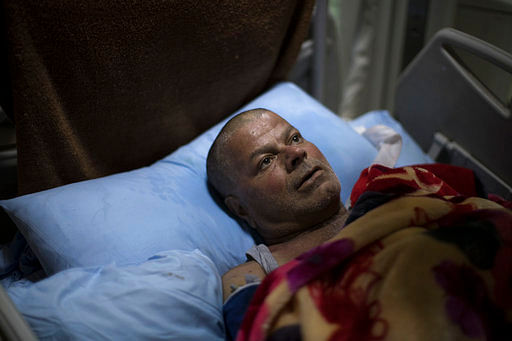 """Ali Zanoun, one of the only survivors of a US strike on a building in Mosul. (Photo: <a href=""""http://www.apexchange.com/pages/OneUp.aspx?id=901661ff12a742798003c400cfd5830d&amp;links=US-LED,AIR,STRIKE,USABL,WK21Y2017,W21Y2017&amp;fid=8018114f620f4c0aaa6bf52e77e412ff&amp;Token=&amp;media=Text&amp;slug=BC-US--Pentagon-Civilians%20Killed,3rd%20Ld-Writethru&amp;format=nitf&amp;site=1"""">AP</a>)"""