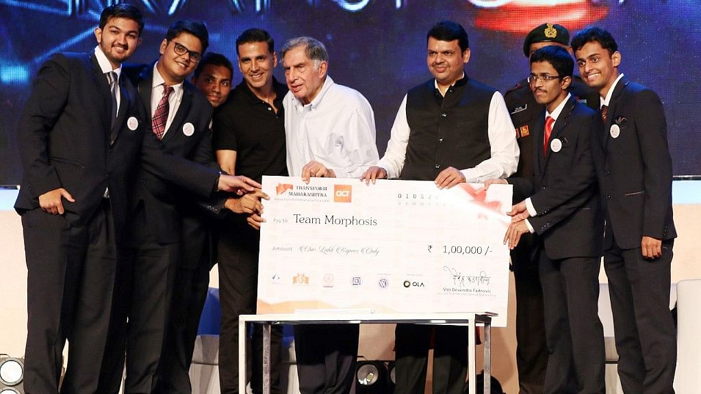 Akshay Kumar, Ratan Tata and CM Devendra Fadnavis hand over a cheque to students. (Photo: Yogen Shah)