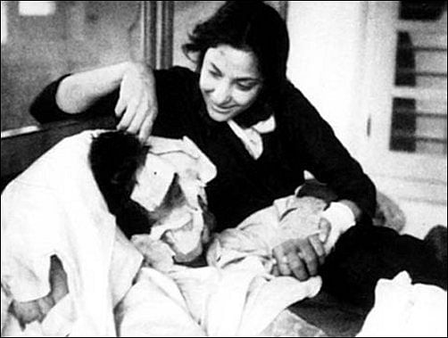 Nargis tends to an injured Sunil Dutt during the filming of <i>Mother India</i>.
