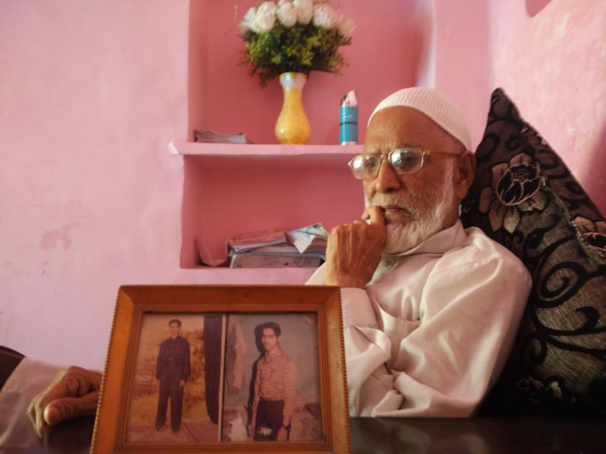 Jaffer with a picture of his sons, Mehtab on the right. (Photo Courtesy: Mahtab Alam)