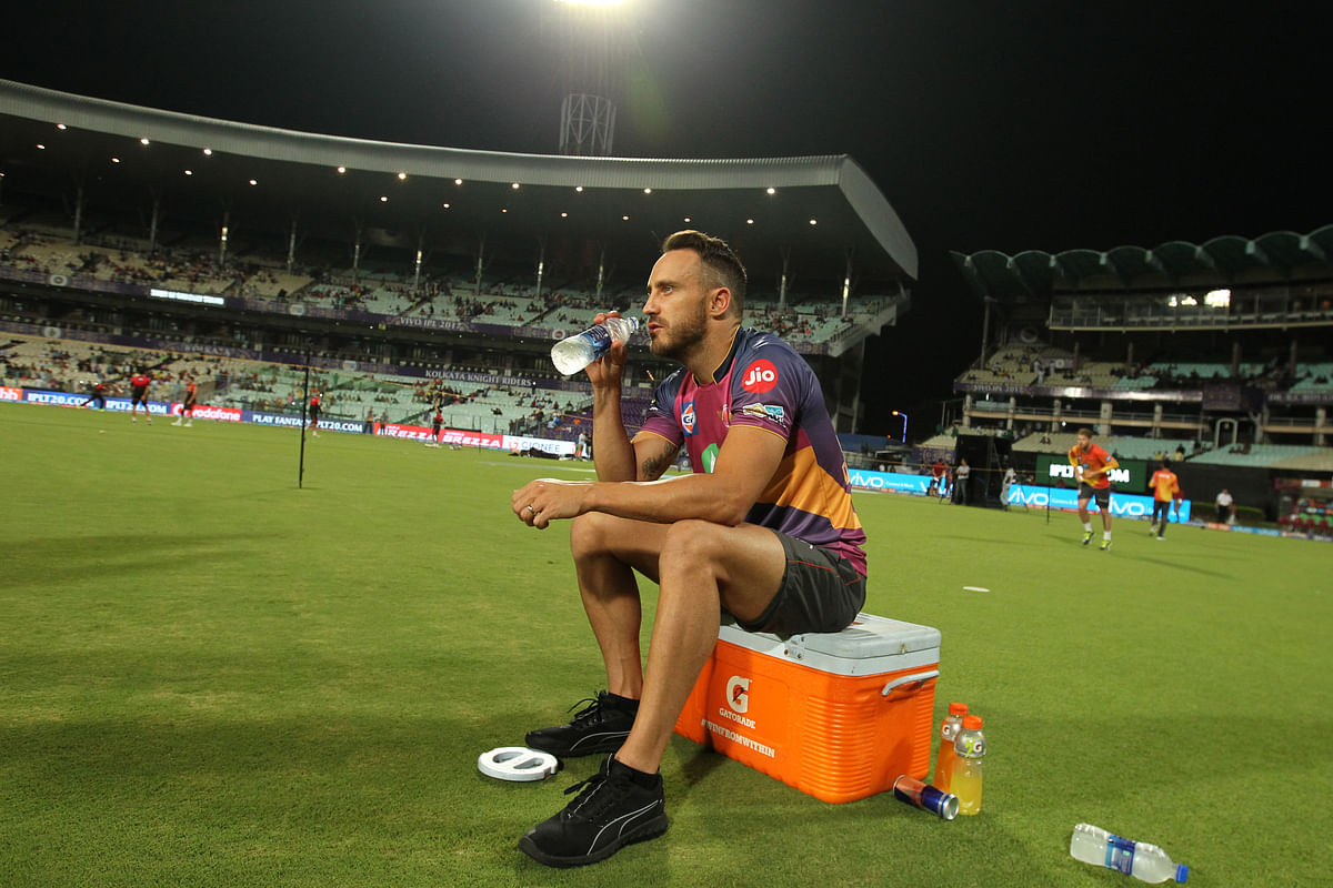 Faf du Plessis has a drink during a warm-up session. (Photo: BCCI)