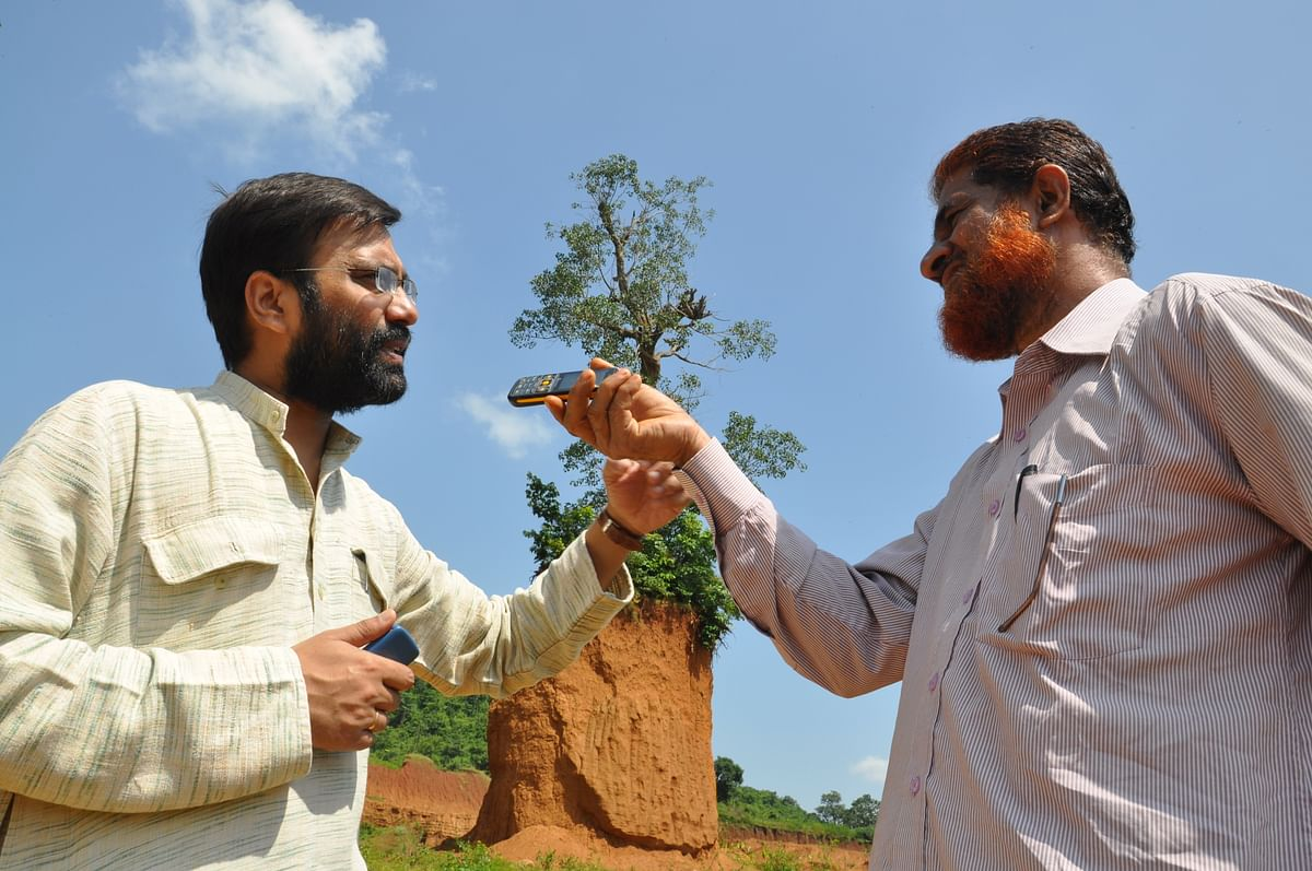"Subhrangshu Choudhary (left) feels Bultoo Radio can be utilised ""to minimise the differences between adivasis and non-adivasis"". (Photo: Purusottam SIngh Thakur)"