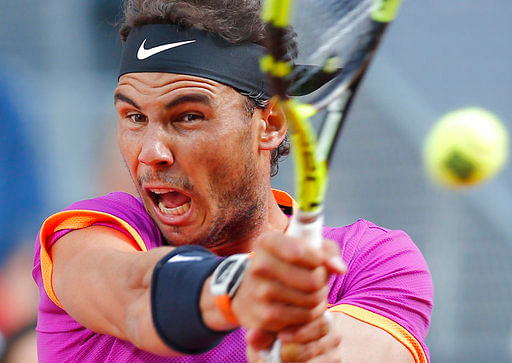 Rafael Nadal plays a shot in the final of the Madrid Open tennis tournament against Dominic Thiem, in Madrid, Spain. (Photo: AP)