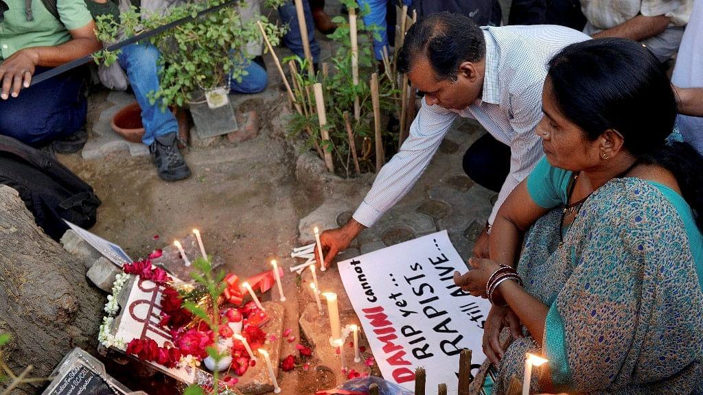 Jyoti Singh's (Nirbhaya) parents Asha Devi and BN Singh light candles at a memorial at Jantar Mantar in New Delhi on 5 May. (Photo: PTI)