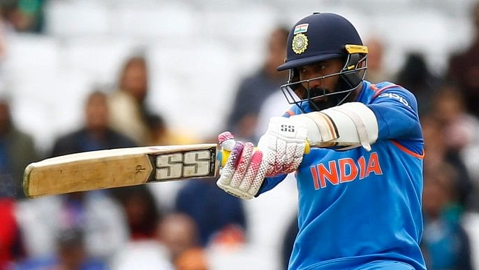 Dinesh Karthik plays a shot during the Champions Trophy warm-up match against Bangladesh.