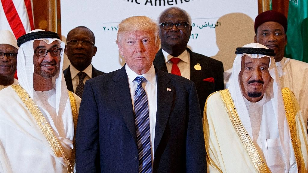 US President Donald Trump poses for photos with King Salman (right) and others at the Arab Islamic American Summit in Riyadh on Sunday. (Photo: AP)