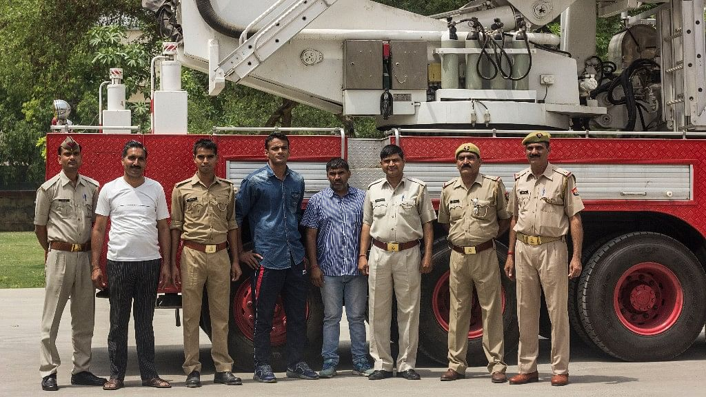 From 23-year-old to 58-year-old – this motley bunch of firemen do their job with pride. (Photo: Abhilash Mallick/<b>The Quint</b>)
