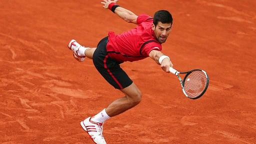 Novak Djokovic stretches to make a return in his quarterfinal match against Tomas Berdych at the French Open tennis tournament in Paris, France. (Photo: AP)