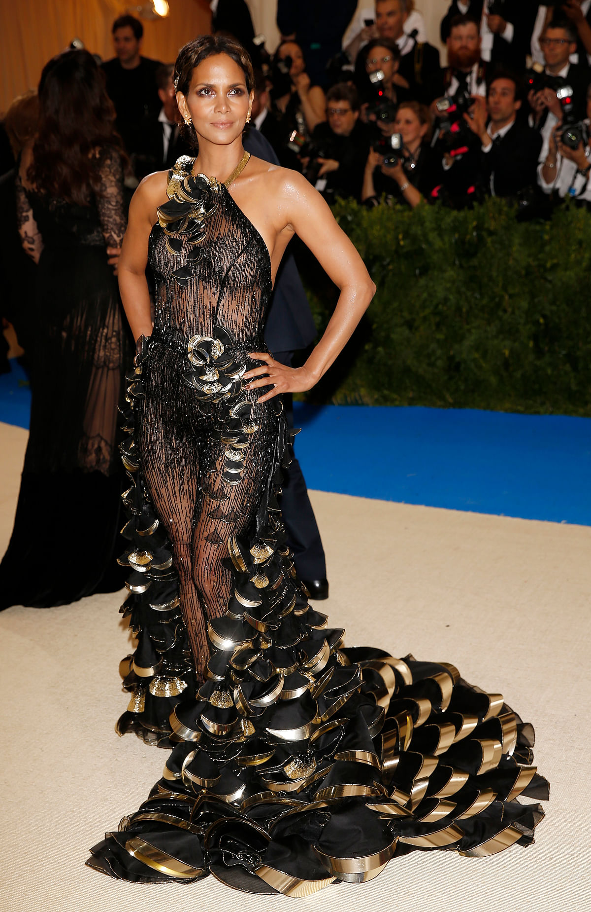 Halle Berry is sexy in a sheer body-hugging halter jumpsuit with an OTT train. (Photo: Reuters)