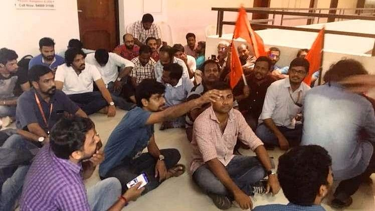 Workers hold a protest at Sun TV's Kochi office. (Photo Courtesy: The News Minute)