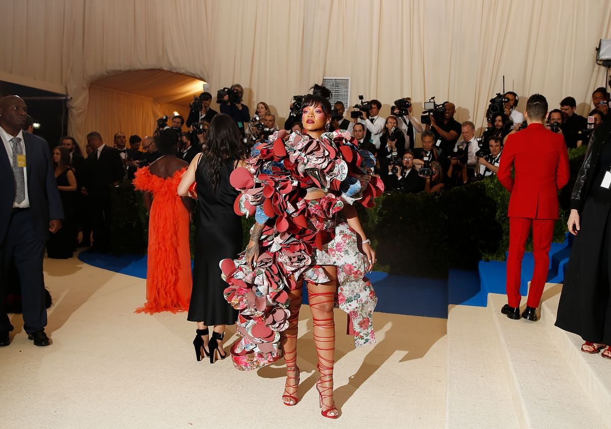 Rihanna in a jaw-dropping Comme des Garçons dress paired with strappy stiletto heels.  (Photo: Reuters)
