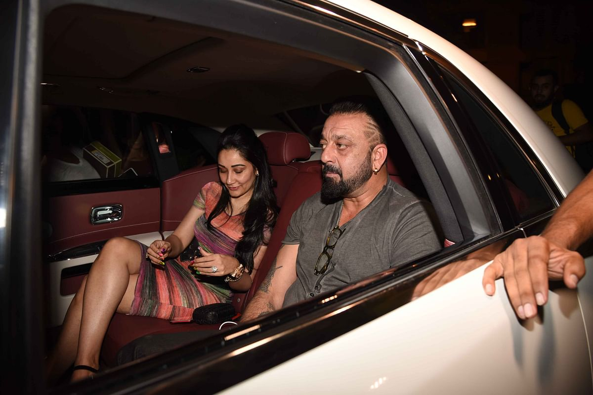 Sanjay - complete with a cool hairdo - and Manyata Dutt arrive for the bash. (Photo: Yogen Shah)
