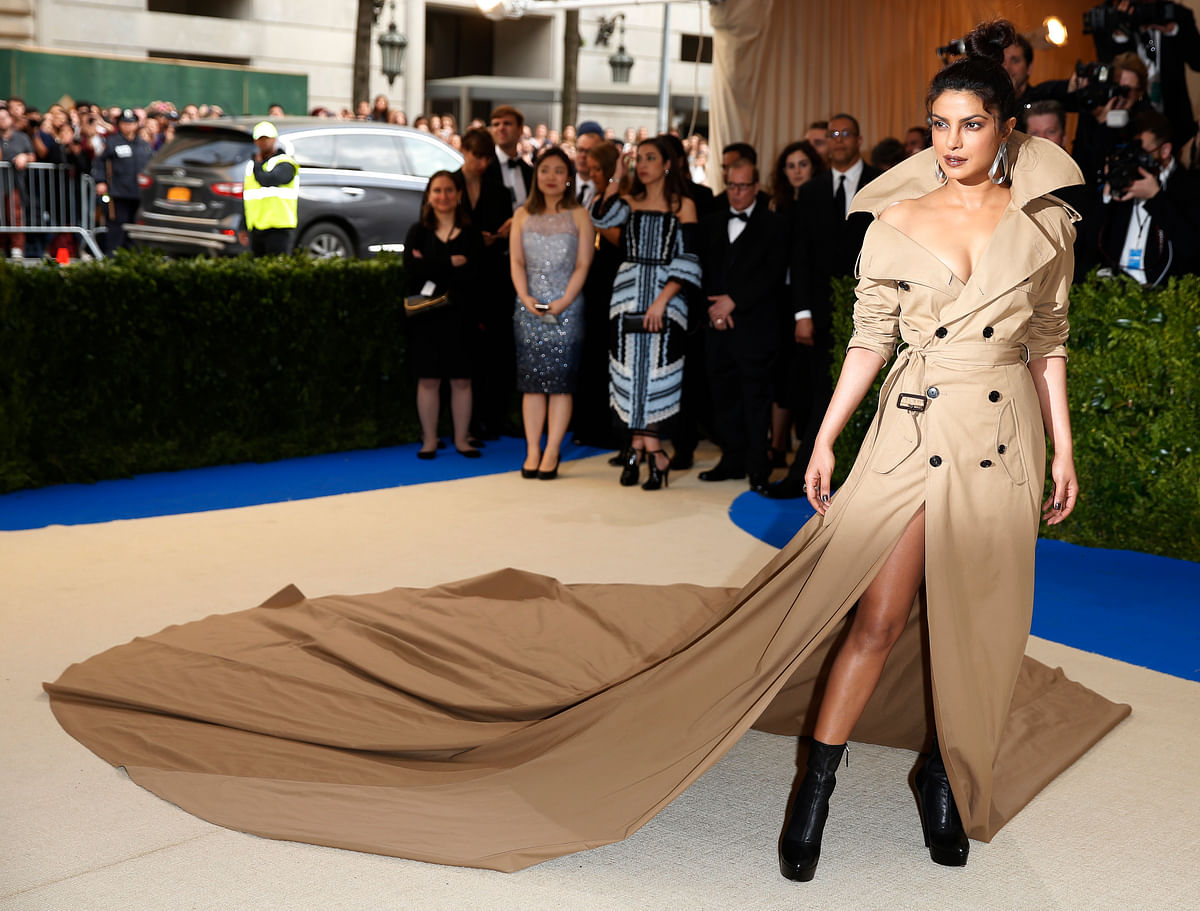 This trench-coat gown is sure to set a helluva trend. (Photo: Reuters)