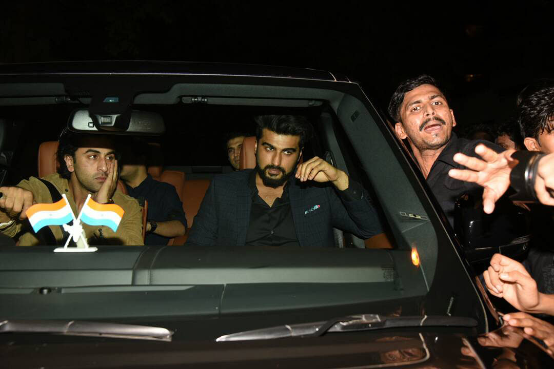 Ranbir and Arjun Kapoor wait for the crowd to clear up. (Photo: Yogen Shah)
