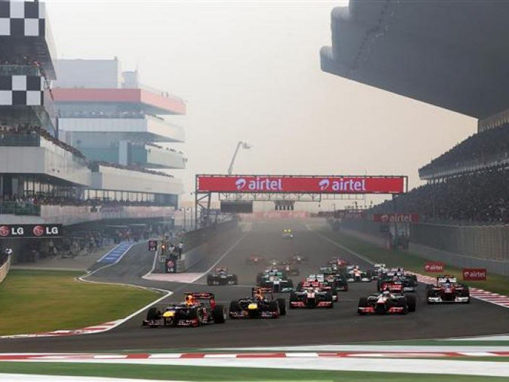 Sebastian Vettel, then of Red Bull Racing leads the field into the first corner at the start of the Indian Grand Prix at the Buddh International Circuit, on 28 October 2012. (Photo Courtesy: Buddh International Circuit)