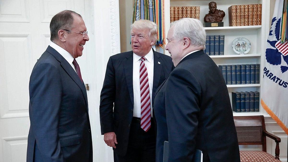 Russian diplomat Sergei Lavron (left) with US President Donald Trump (Centre) (Photo: AP)