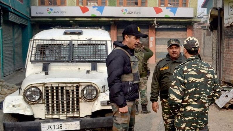 Senior Police and Army officers inspect a Jammu and Kashmir Bank branch. (Photo: PTI)