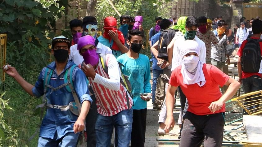Students pelt stones on security personnel in Srinagar on 15 May 2017. (Photo: IANS)