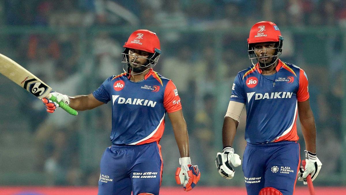 Delhi Daredevils' Rishab Pant, left, raises his bat after scoring half century and Sanju Samson walk besides him during their Indian Premier League. (Photo: AP)