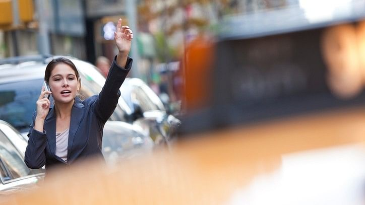 Representational image of a woman hailing a cab. (Photo: iStock)