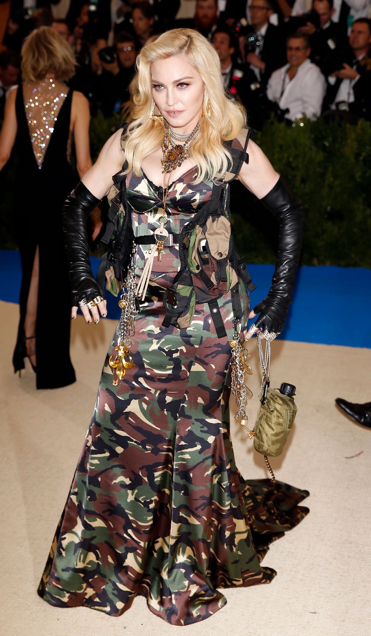 Madonna flaunts a full length camouflage Moschino gown. (Photo: Reuters)