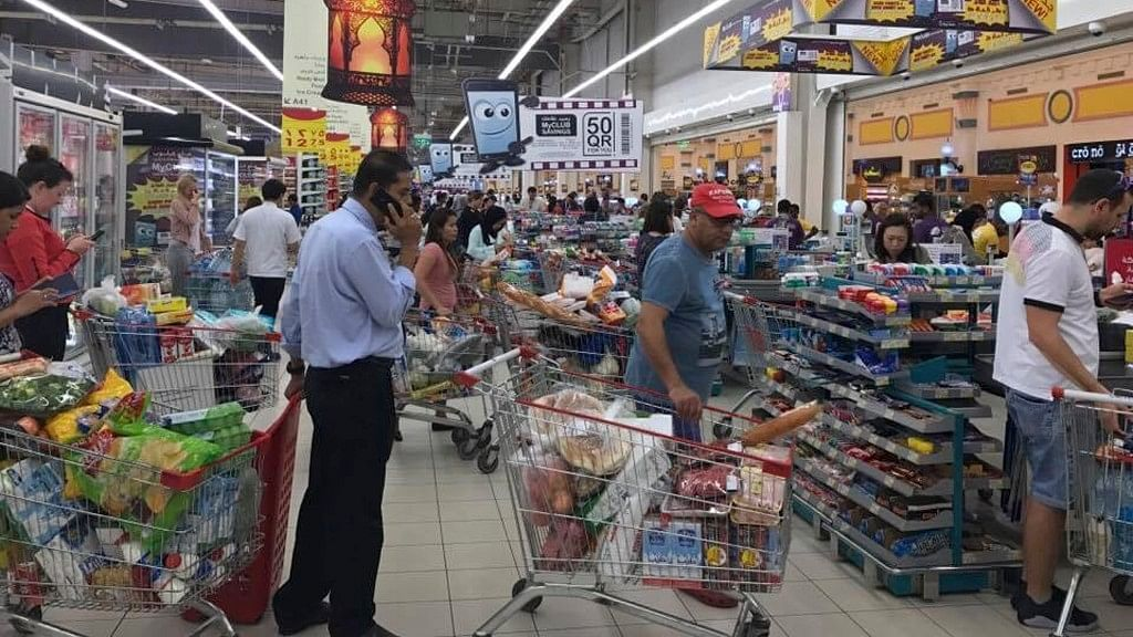 In this photo provided by Doha News, shoppers stock up on supplies at a supermarket in Doha on 5 June after Saudi Arabia closed its land border with Qatar. (Photo: AP)