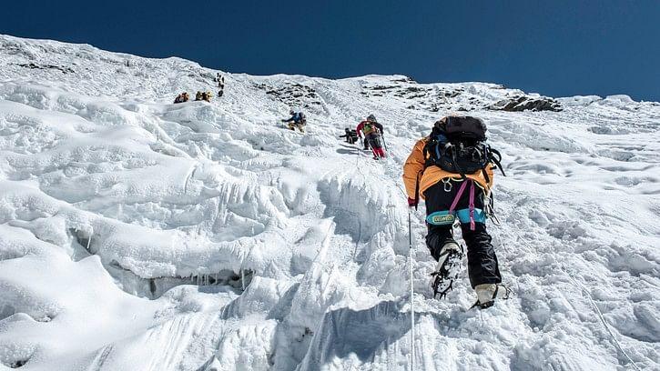 Climbers climbing the ice wall to the top of Island Peak (Imja Tse) summit (6189m) in the  Everest region, Nepal. (Photo: iStock)