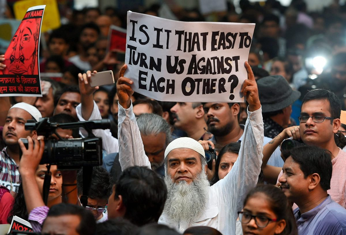 """A protester asks, """"Is it that easy to turn us against each other?"""" at the 'Not in My Name' protest in New Delhi."""