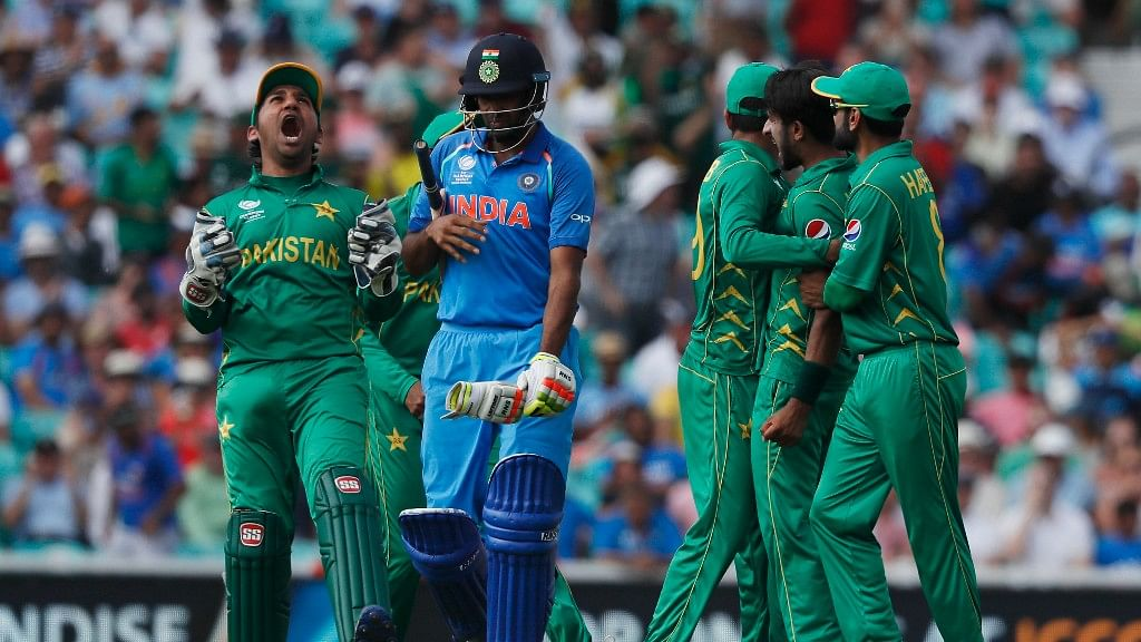 Pakistan's captain Sarfraz Ahmed, right, celebrates the dismissal of India's Ravichandran Ashwin, left, during the ICC Champions Trophy final.