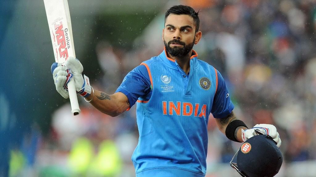 Indian cricket captain Virat Kohli leaves the field at the end of an innings during the ICC Champions Trophy match between India and Pakistan. (Photo: AP)