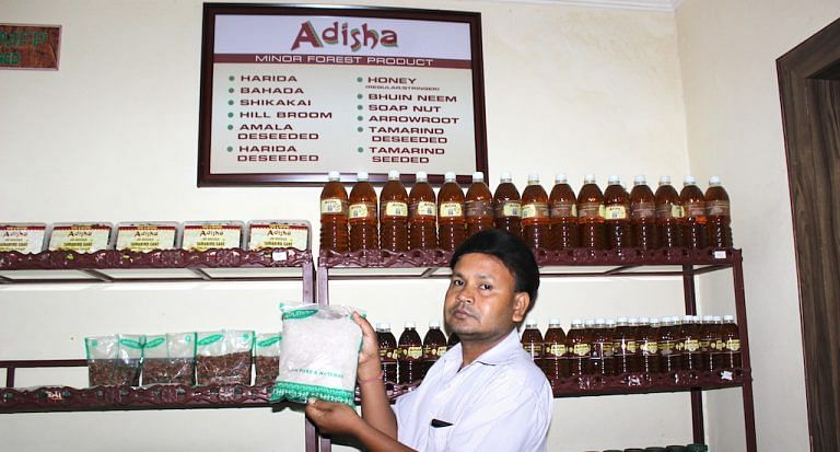 At a Bhubaneswar government outlet for minor forest products, a shop assistant holds up their fastest moving item, the powdered millet packet, whose sale has doubled in the last year.
