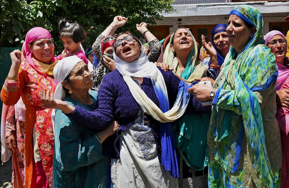 Family members and relatives mourn the death of Dy SP Mohammad Ayub Pandith at his residence in Srinagar on Friday.