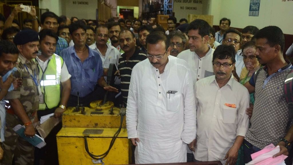 West Bengal Sports Minister Aroop Biswas receives the coffins of Paresh Chandra Nath and Gautam Ghosh who died on Everest last year, Kolkata airport, 1 June, 2017. (Photo: IANS)