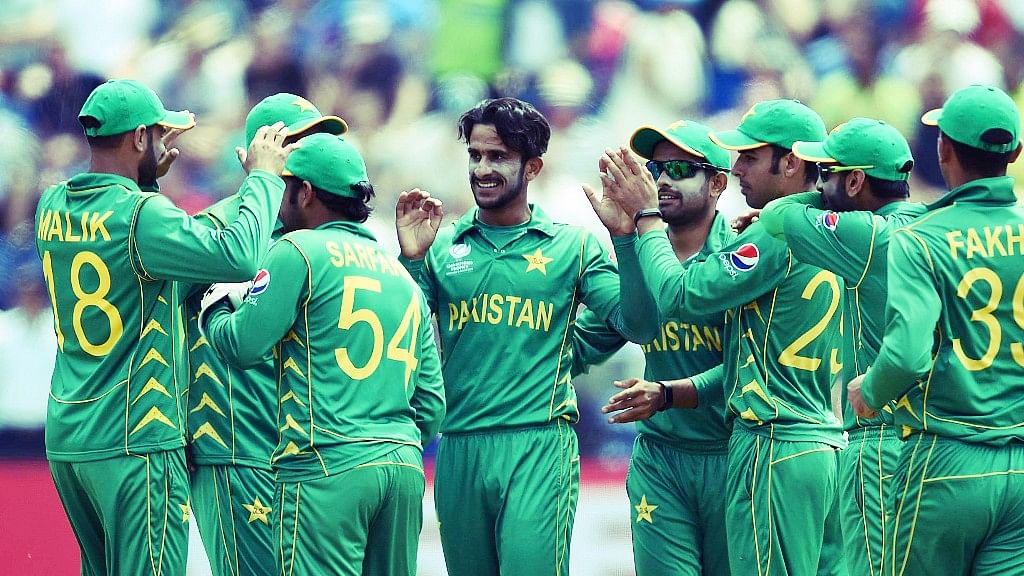 Pakistan's Hasan Ali, centre, celebrates  a wicket with his team-mates during the  ICC Champions Trophy. (Photo: AP)