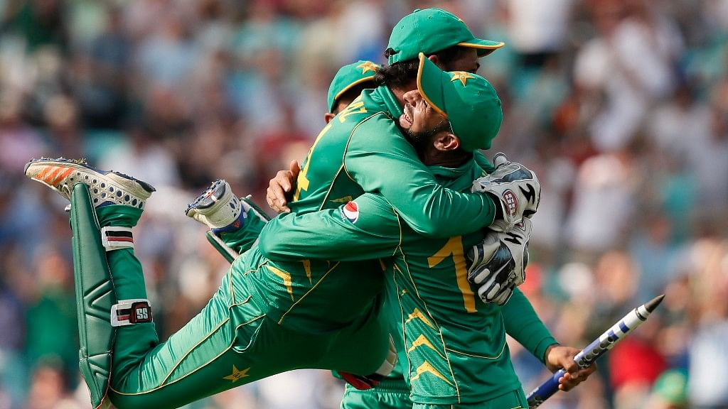 Pakistan's captain Sarfraz Ahmed, left, jumps over a teammate after they defeated India by 180 runs during the ICC Champions Trophy final at The Oval in London. (Photo: AP)
