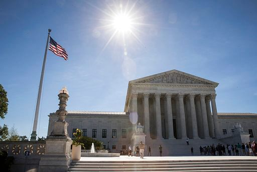 People visit the Supreme Court as justices issued their final rulings for the term, in Washington on 26 June 2017.