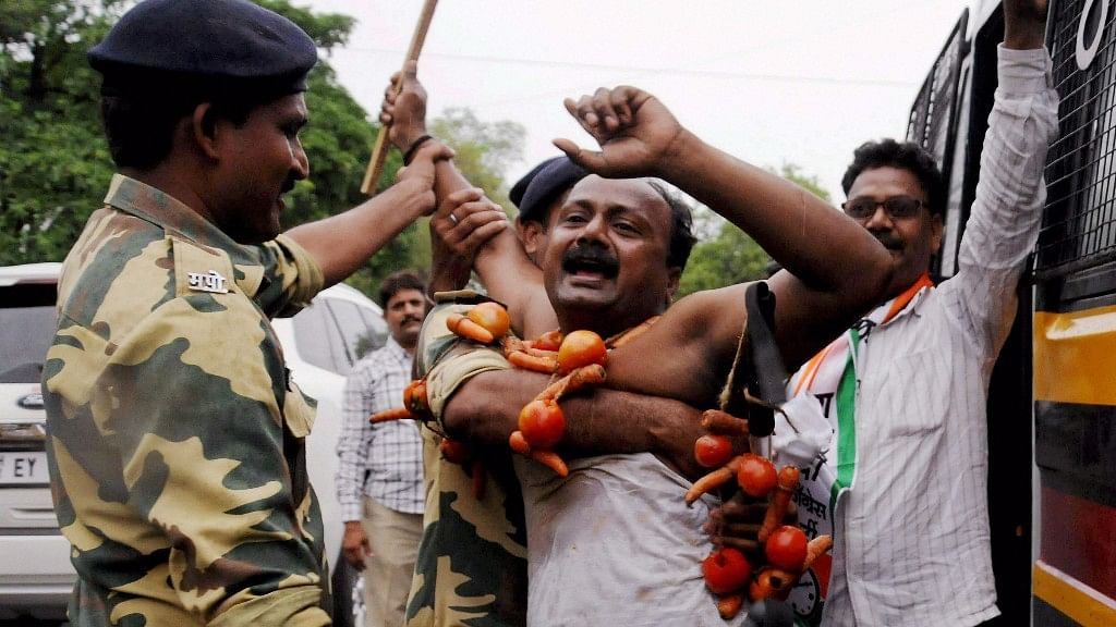 Police detain NCP farmers during a protest as part of their Maharashtra bandh over various demands, in Nagpur on Monday. (Photo: PTI)
