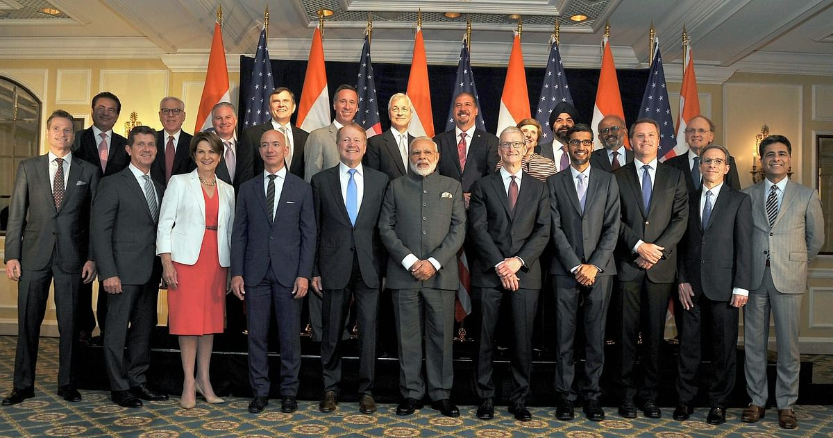 Prime Minister Narendra Modi pose for a group photograph with  US business leaders at a meeting in Washington DC on Sunday. (Photo: PTI)