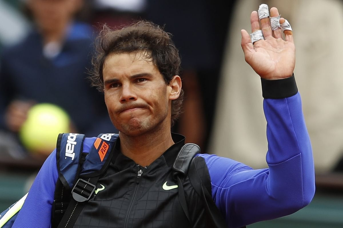 Rafael Nadal waves to the crowd after he booked his spot in the semi-finals. (Photo: AP)