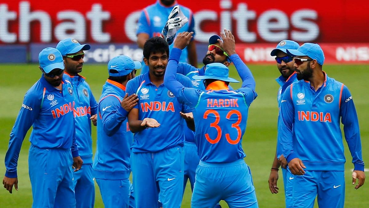 The Indian team celebrate a wicket during a warm-up game before the start of the Champions Trophy. (Photo: Reuters)