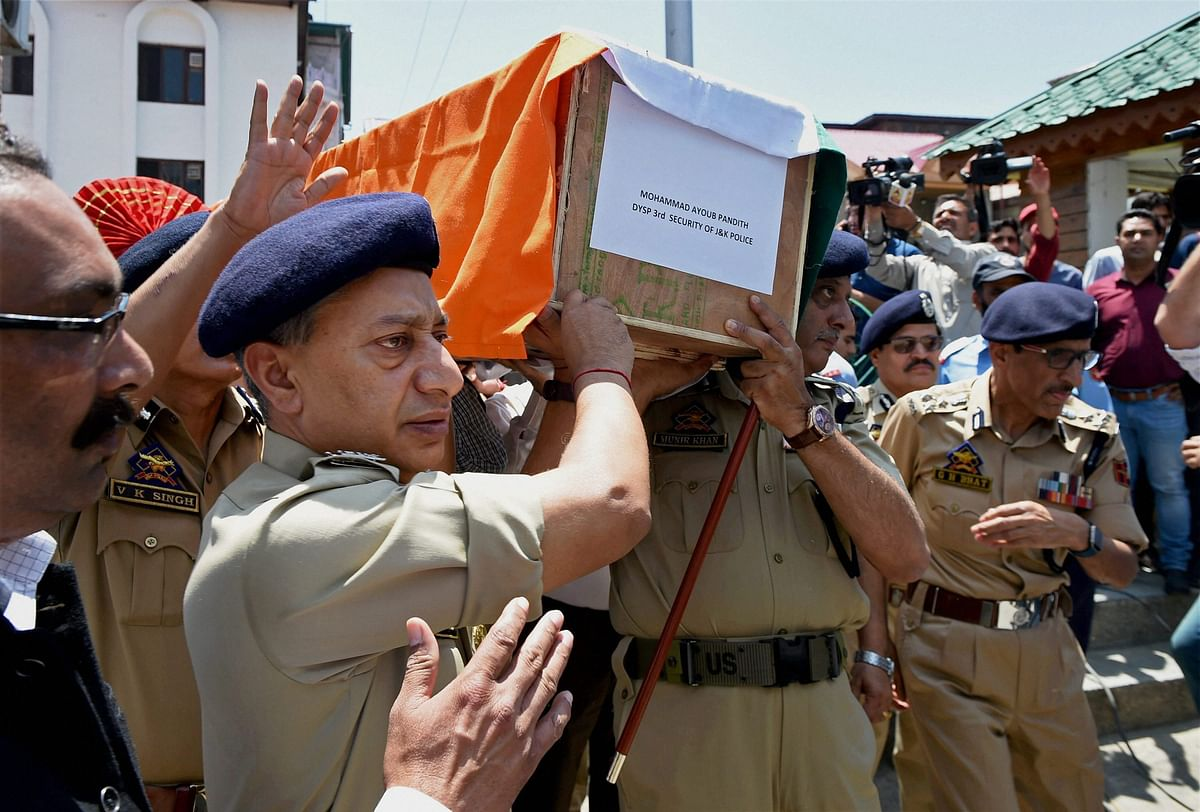 Director General of Jammu and Kashmir Police S P Vaid and other senior officers carrying the coffin of DSP Mohammad Ayub Pandith during a wreath laying ceremony at District Police Lines in Srinagar on 23 June.